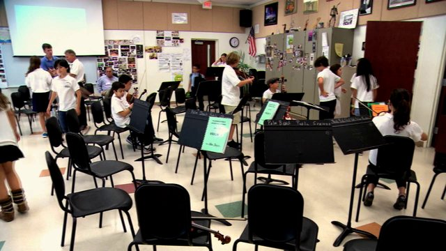 Strings Students prepare for lessons at Palm Beach Public Elementary School Orchestral Strings Program